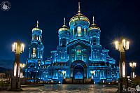 Resurrection Cathedral in Blue Framed by Street Lamps