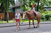 Lovely Girl in Red Hat on Horseback in Suzdal