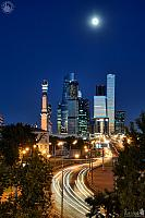 Moskva-City Skyscrapers and Car Light Trails Under Moonlight