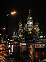 Traffic at St. Basil's Cathedral on a Rainy Evening