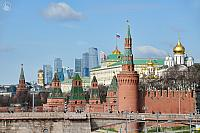 Towers of Moscow Kremlin Against Moskva-City in Spring