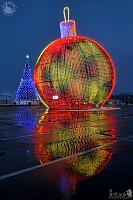 Colored Christmas Tree Ball with Reflection in Morning Twilight
