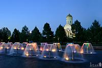 Colorful Fountains and Church of St. George in Twilight