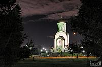 Church of St. George framed by Trees on Poklonnaya Hill at Night
