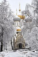 Smolensky Church and Prohorov Chapel Framed by Trees in Snow