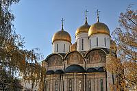 Golden Domes of Dormition Cathedral Framed by Golden Trees