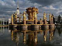 Golden Statues Under Grey Skies