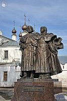 Monument to Peter and Fevronia against  Trinity Church Domes