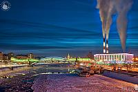Icy Moskva River and Steam Clouds Rising Up in Winter Twilight