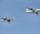 Aircraft Il-78 Demonstrates Aerial Refueling Flying over Red Square