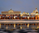 Moscow Kremlin with Reflection in Icy Moskva River in Twilight