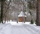 Way to the Old Wooden Chapel in Woods in Snowfall