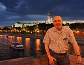 In Background of Moscow Kremlin under Cloudy Sky in Twilight