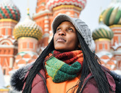 In Background of Amazing Domes of St. Basil's Cathedral in Snow